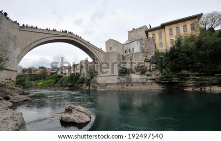 MOSTAR, BOSNIA-HERCEGOVINA, APR 15: Tourist at the old bridge of Mostar which was destroyed in the war and rebuild in 2004. Taken on april 15, 2014 in Mostar, Bosnia. - stock photo