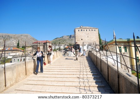 MOSTAR, BOSNIA - SEPTEMBER 17: The restored Old Bridge on September 17, 2008 in Mostar, Bosnia. The symbol of Mostar destroyed in the war, but rebuilt with the help of UNESCO. World Heritage site. - stock photo