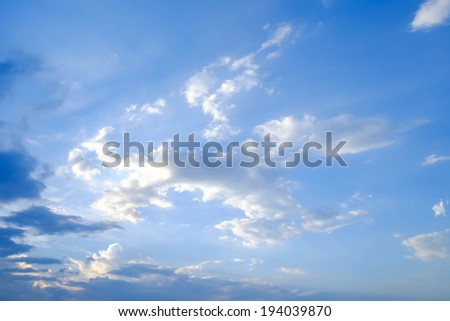 mostly cloudy and blue sky - stock photo
