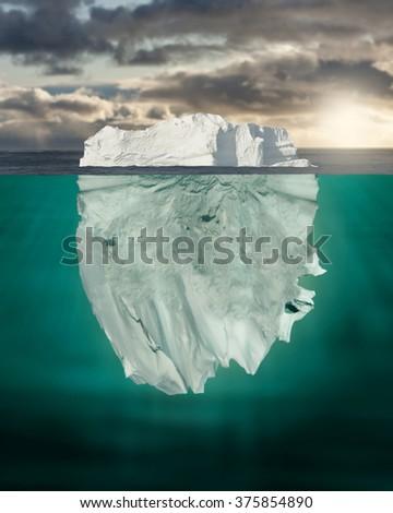 Mostly Underwater Iceberg Floating in Ocean - stock photo