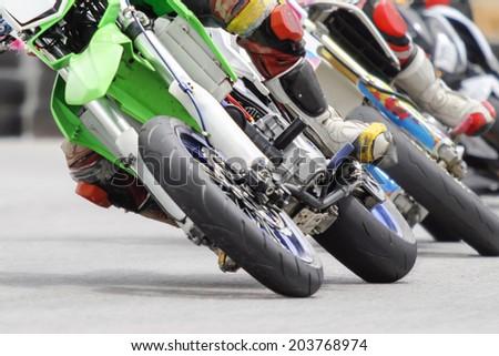 Motard motorcycle in corner of track - stock photo