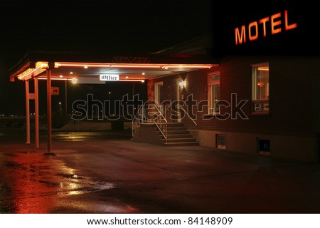 Motel entrance at night - stock photo