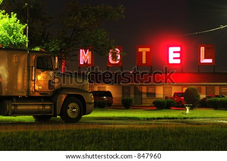 motel neon sign (some noise) - stock photo