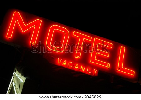 Motel sign lit up at night - stock photo