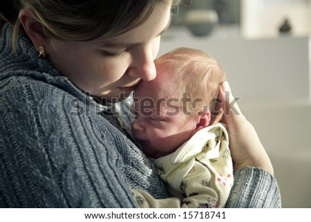 Mother affectionately holding her newborn baby