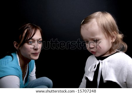 Mother and a sad child, isolated - stock photo