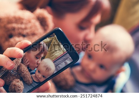 Mother And Adorable Baby Boy In Suitcase Taking Selfie While They Are Getting Ready For Traveling