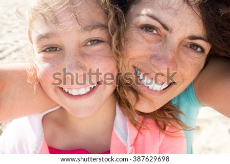 Mother and adult daughter are doing Selfie on the beach
