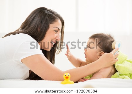 Mother and baby after bathing - stock photo