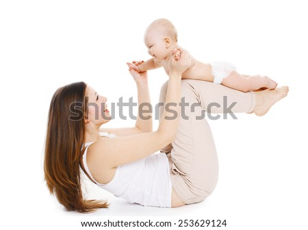 Mother and baby are doing exercise and having fun on a white background - stock photo