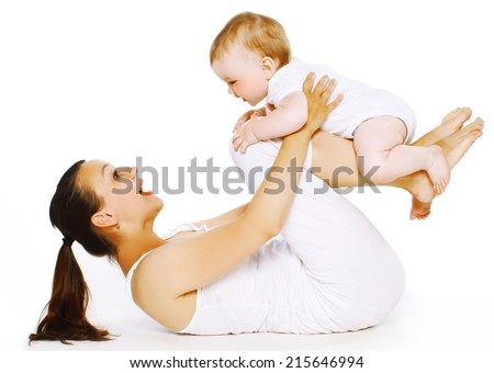 Mother and baby are doing exercise, gymnastics, fitness, play - concept - stock photo