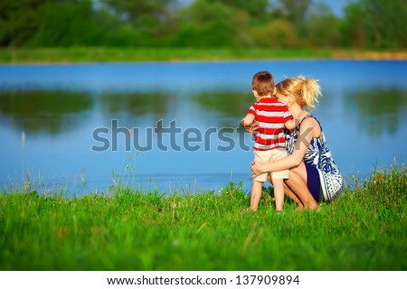 mother and baby boy relationships, colorful outdoors - stock photo