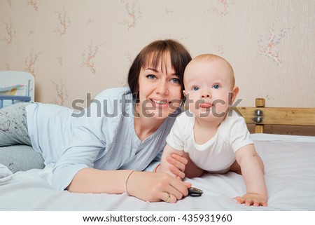 Mother and baby closeup portrait, happy faces, Adorable child, mom and kid having fun indoor, parents joy, holding little child, healthy toddler and mom - stock photo