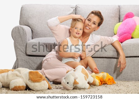 Mother and baby daughter playing 7 - stock photo