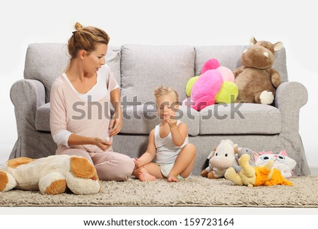 Mother and baby daughter playing 2 - stock photo