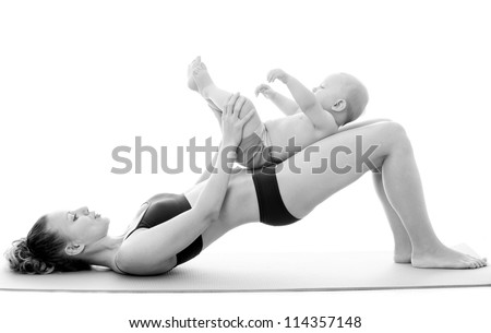 Mother and baby doing exercise - stock photo