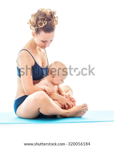 Mother and baby doing yoga  exercise.  Mother and baby gymnastics.