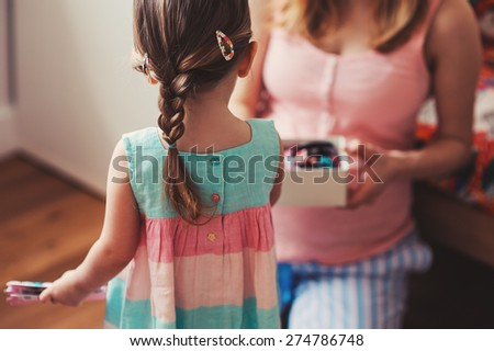 mother and baby girl at home - stock photo