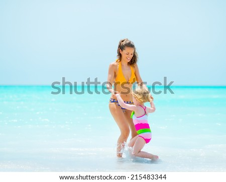 Mother and baby girl at seaside