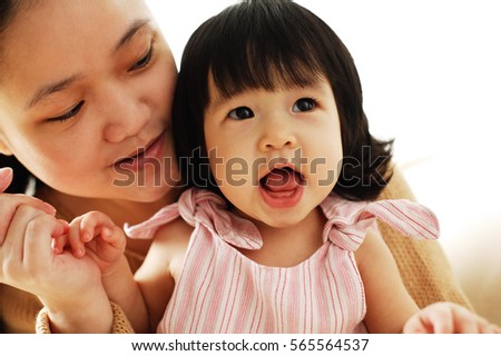 Mother and baby girl, portrait