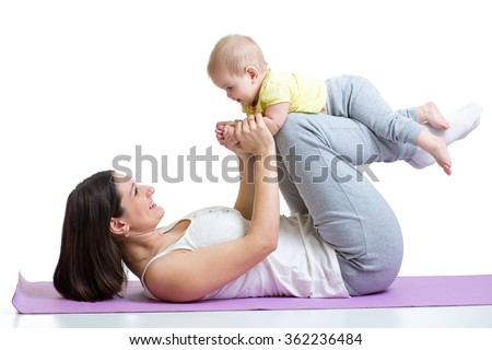 mother and baby gymnastics, yoga exercises isolated on white  - stock photo