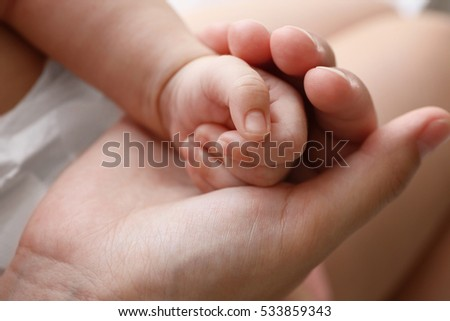 Mother and baby hands, close up view