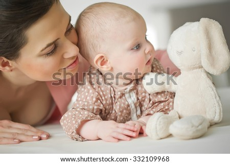 Mother and Baby. Happy Family. Mom With her Child. - stock photo