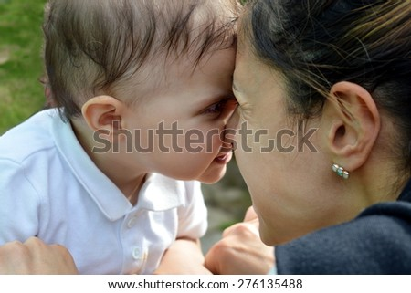 mother and baby hug outdoor - stock photo