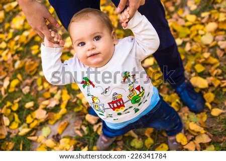 Mother and baby in suburban park outdoor - stock photo