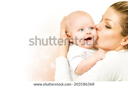 Mother and Baby kissing and hugging. Beautiful mom with her child portrait. Happy Family isolated on a white background. Parenthood, motherhood concept  - stock photo
