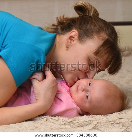 Mother and Baby kissing and hugging. Happy Family - stock photo