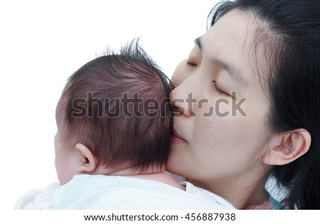 Mother and baby, Lovely asian baby resting on her mother's shoulder, on white background. Mother kiss her daughter. Happy family spending time togetherness. Mother's Day celebration. - stock photo