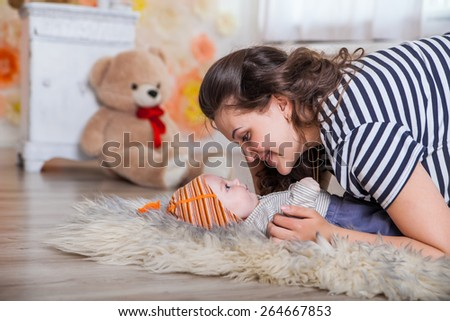 mother and baby lying on the floor