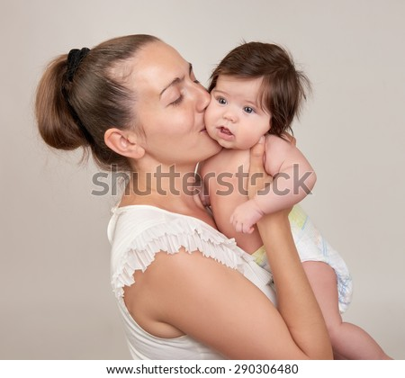 mother and baby on white background - stock photo