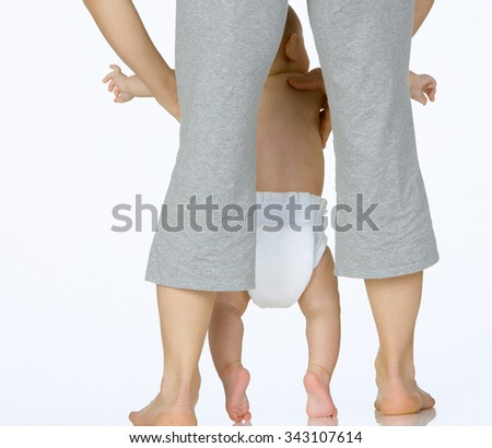 mother and baby playing - stock photo