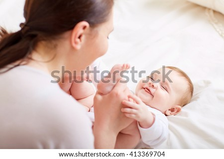 Mother and baby playing and laughing. A happy family - stock photo