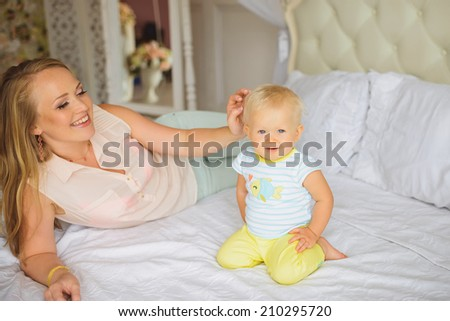Mother and Baby playing and Laughing. Mom With her Child. Happy Family
