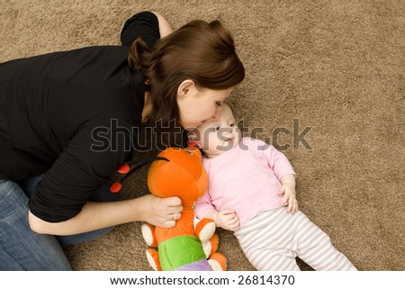 Mother and baby playing in home