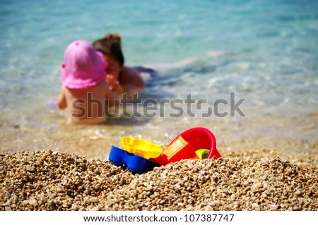 Mother and baby playing on the beach