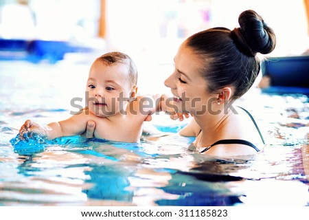 Mother and baby relaxing in the swimming pool