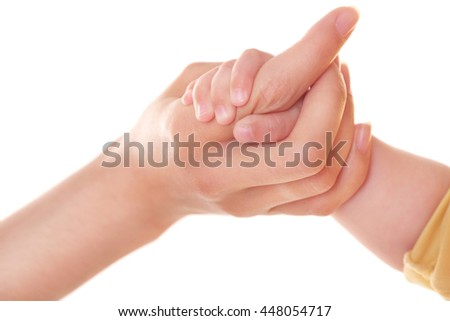 Mother and baby's hands isolated on white