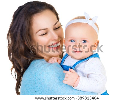 Mother and Baby smiling together. Love. Happy cheerful family Mom and Baby girl kissing and hugging. Beautiful healthy mother and little daughter. Maternity concept. Parenthood. Isolated on white