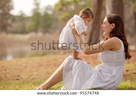 Mother and Baby Son First Steps - stock photo