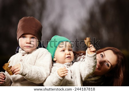 Mother and boys in garden - stock photo