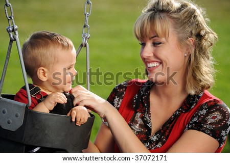 Mother and Child at playground - stock photo