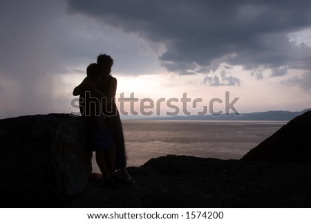 Mother and child facing the storms of life together. Concept for single parent. - stock photo