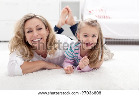 Mother and child having fun together at home - stock photo