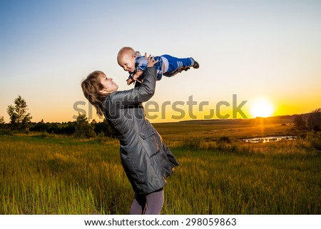 mother and child looking at the sunset