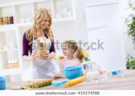Mother and child making bread together