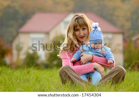 mother and child on background of the home